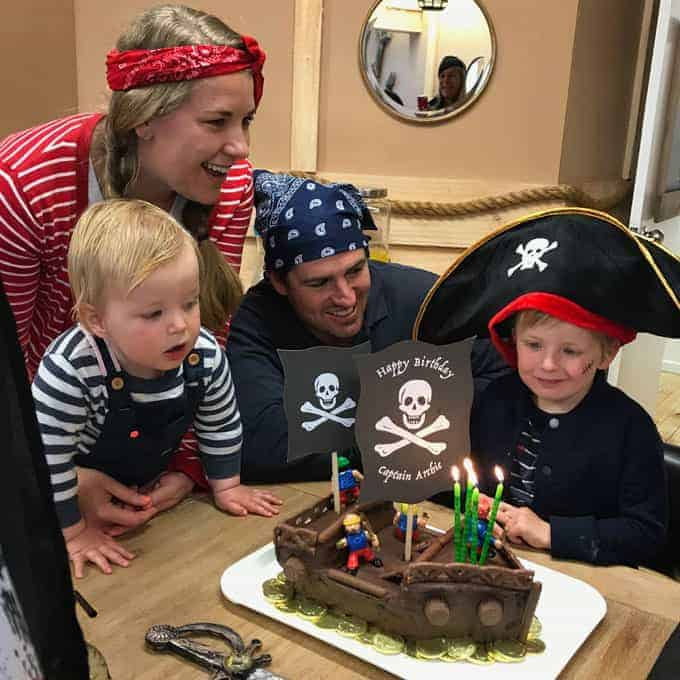 Vanya and family looking at a pirate cake for Archie.