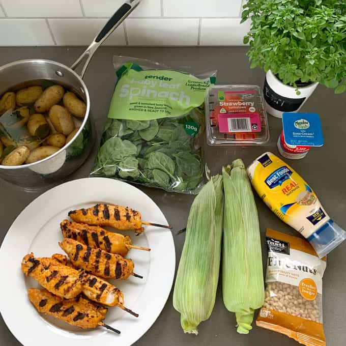 BBQ chicken, corn and potato salad ingredients