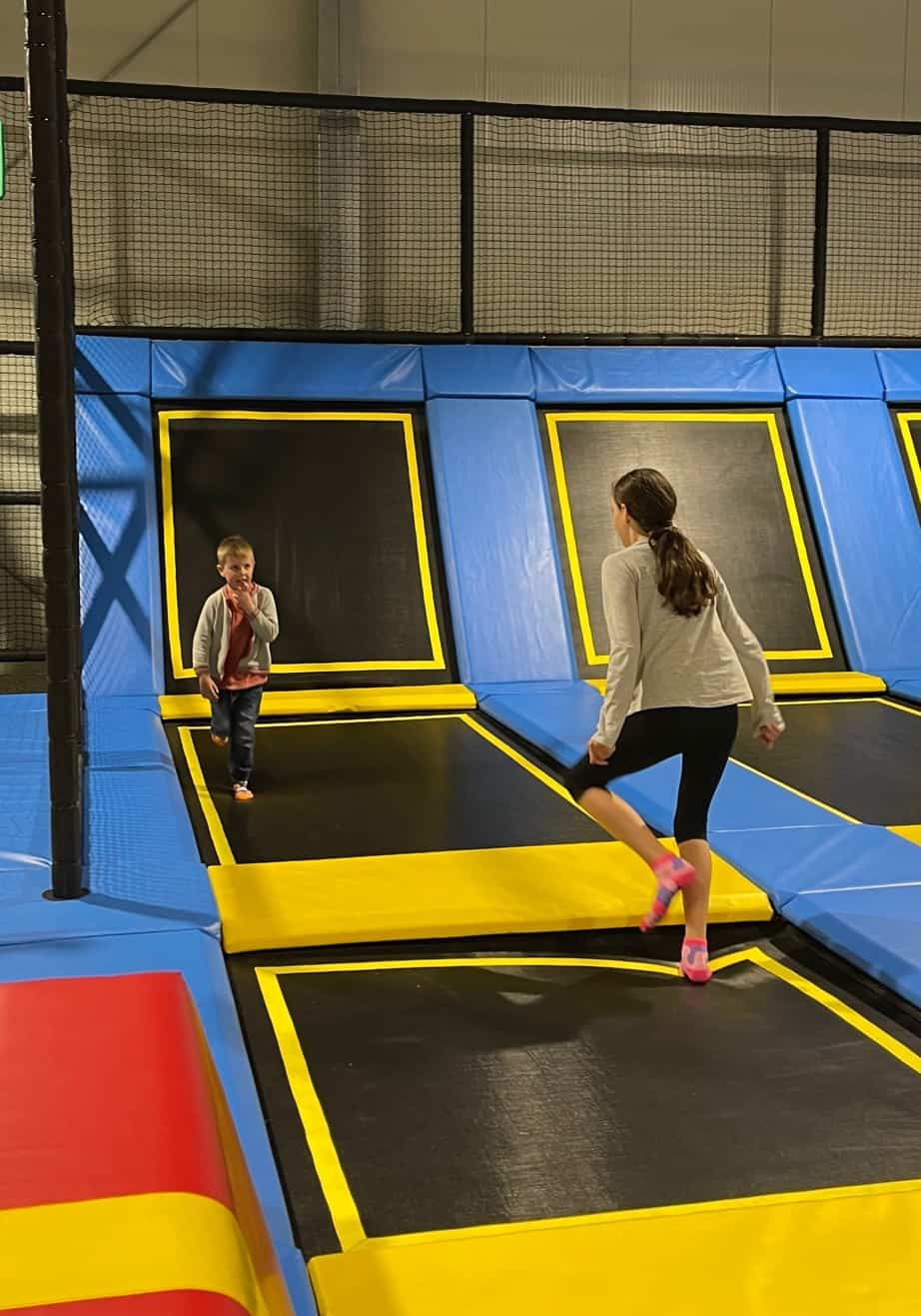 A boy and girl at a trampoline park