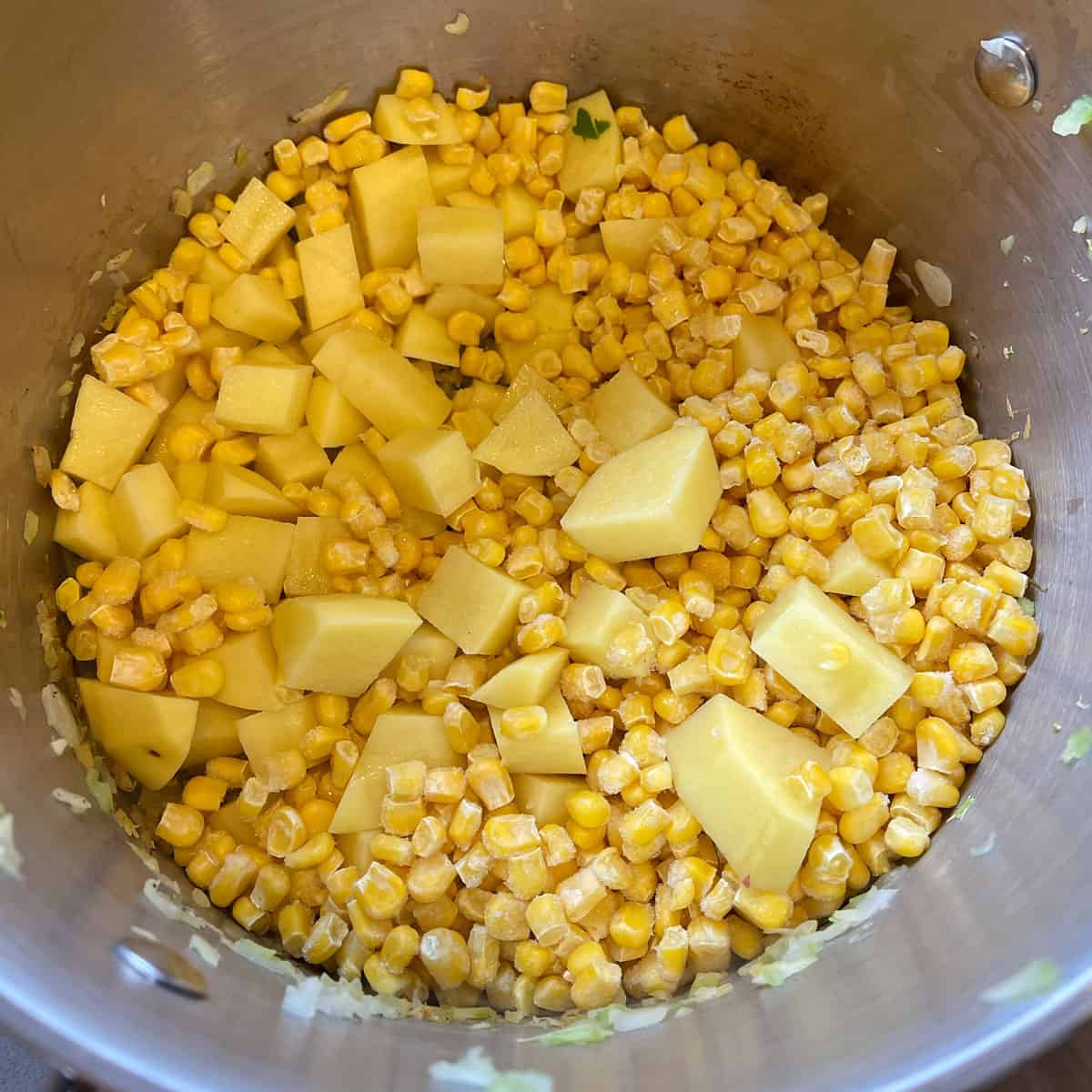 corn and chopped potatoes in a large pot